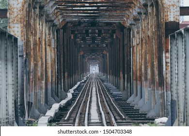 Iron railroad bridge point perspective with a human silhouette in the center in Hanoi, Vietman