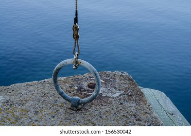 Iron ring attached to the concrete by the sea