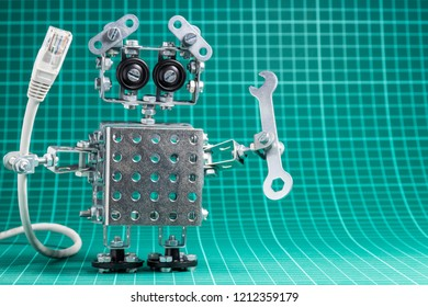 An iron robot holds a rj45 cable and a wrench..