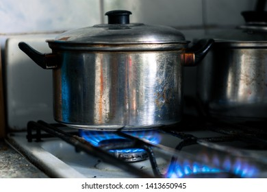 Iron saucepan on the gas stove. Cooking soup or other liquid food