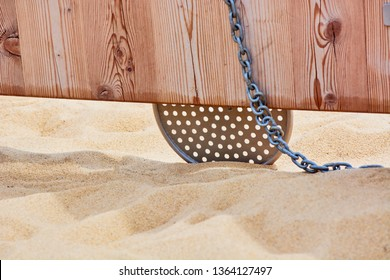 Iron sieve on chain for sifting sand in childrens sandbox for children