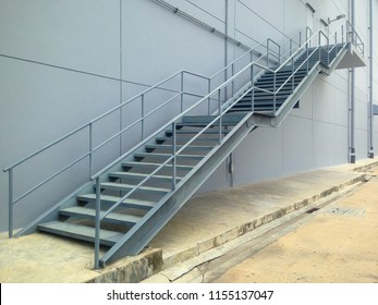 Iron staircase for up to maintenance work.  Steel stairs are on the side of the building walls.