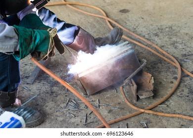 Iron and steel welder working in industry.