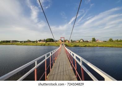 Iron suspension bridge. Russia, Severodvinsk, the island of Yagry