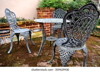 Iron table and chairs on a brick patio