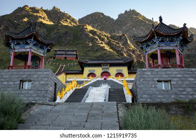 """Iron Tile Taoist Temple at the Heavenly Lake of Tianshan (Tianchi) - Alpine lake in Xinjiang Province, China. Also known as the Pearl of Heavenly Mountain. Translation: """"Iron Tile Temple"""""""