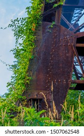 Iron Train Trestle Support Overgrown With Native Plants