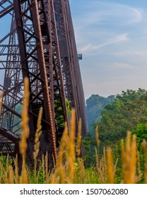 Iron Train Trestle Supports Over The River Valley