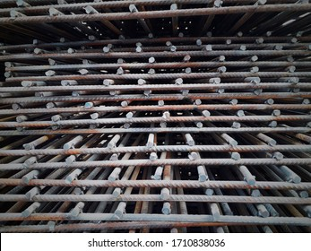Iron welding and grinding marks or textures on iron pipes and rods in a workshop / making of grill or forged from rusty iron rods