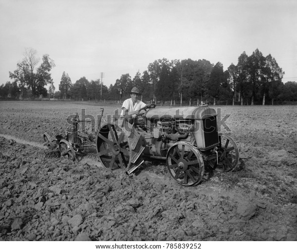 Iron wheeled 'Fordson' was powered by an internal combustion engine, c. 1925. Henry Ford produced his first gasoline powered tractor in 1907, calling it 'automobile plow'