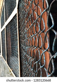 iron wire fence. rusty grill