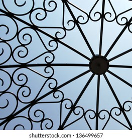 Iron work heart pattern against blue sky