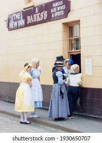 IRONBRIDGE, ENGLAND - JULY 21 2012: Performers from Alice through the looking glass on their break outside The New in pub at Blists Hill Working Museum,  a popular tourist attraction