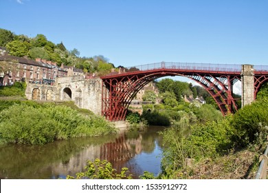 Ironbridge, Shropshire, UK. 11th May, 2019. A view of the newly red painted Iron bridge over the River Severn on a sunny day with a clear blue sky.