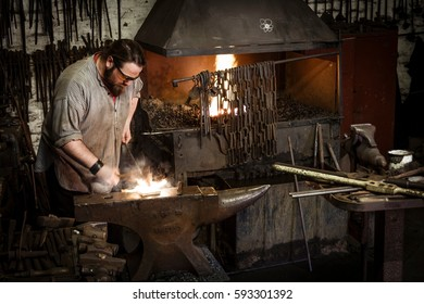 IRONBRIDGE, UK - CIRCA 2013: Blacksmith working in workshop at the Blists Hill Victorian Museum, Ironbridge, Shropshire, UK