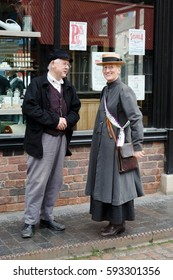 IRONBRIDGE, UK - CIRCA 2013: People in period costume at Blists Hill Victorian Museum, Shropshire, UK