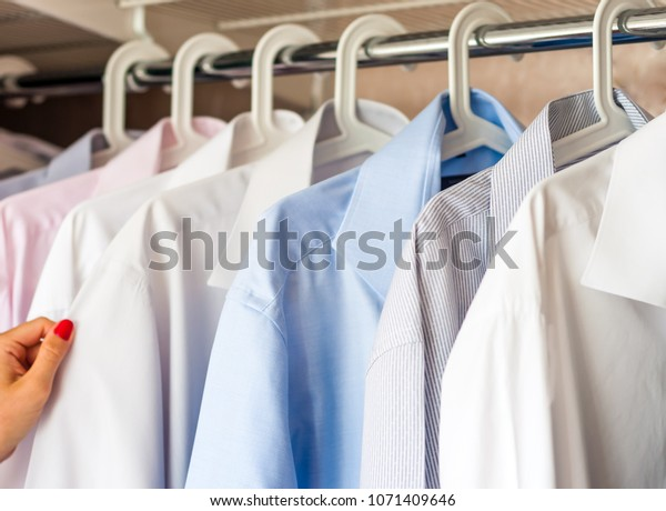 ironed shirts in the closet, selection