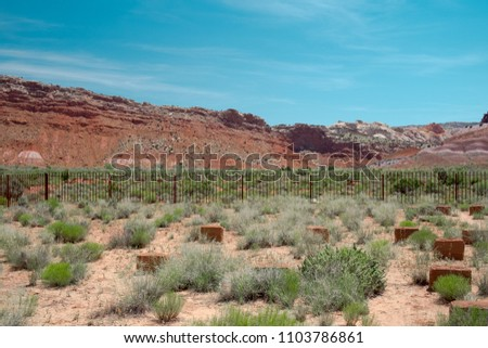 ac4e7019510 An iron-fenced graveyard at the Paria Townsite which is a ghost town that  was