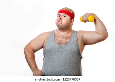 Ironic portrait of plump fat man dressed in casual singlet holding a small yellow dummbell in such manner as if he lifting heavy weights