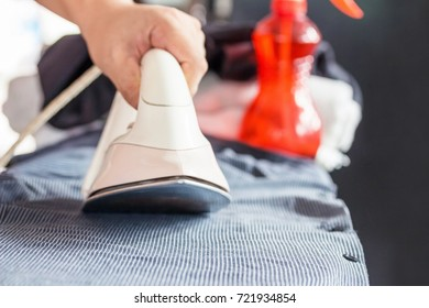Ironing with iron,Bored home work