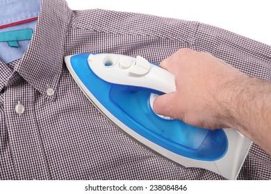 Ironing a shirt on white background
