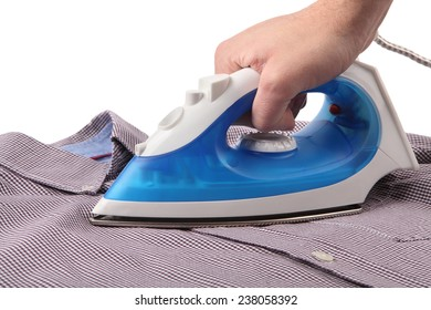Ironing a shirt with a steam iron on white background