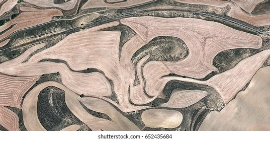 irregular,allegory, tribute to Matisse, Picasso, abstract photography of the Spain fields from the air, aerial view, representation of human labor camps, abstract, cubism,abstract naturalism
