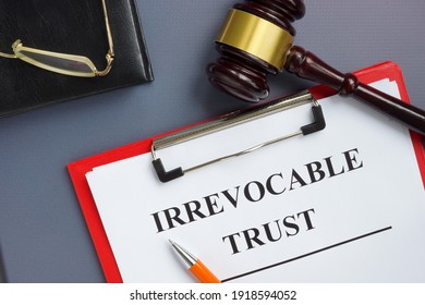 Irrevocable trust document on the clipboard and gavel.