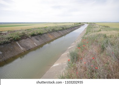 Irrigation artificial channel flooded with water in the planes of eastern Romania