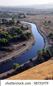 An irrigation canal distributing water to farms in the San Joaquin Valley, California