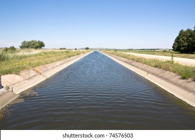 Irrigation channel in the Greek countryside. Diminishing perspective