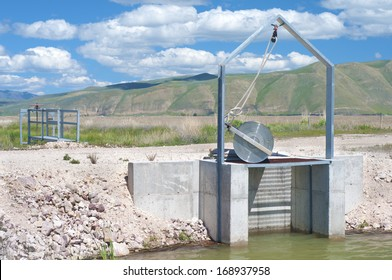 Irrigation Dike Flood Control Gate showing both sides with a road over the top of it in Bear Valley Wildlife Refuge in Idaho.  Horizontal.  Also known as Dingle Swamp or Dingle Marsh