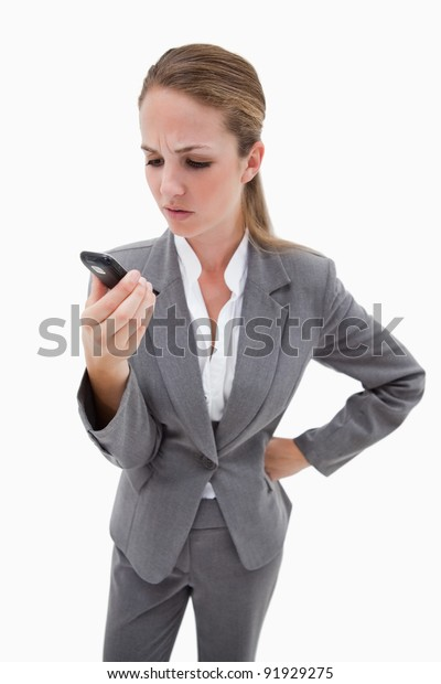 Irritated bank employee reading text message against a white background