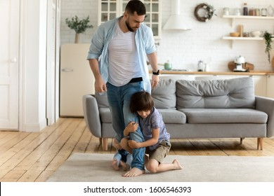 Irritated father leaving while his children keep him not letting go. Mom dad separation, kids passing through parents divorce, alimony, another family, cheater, psychological effects of split concept