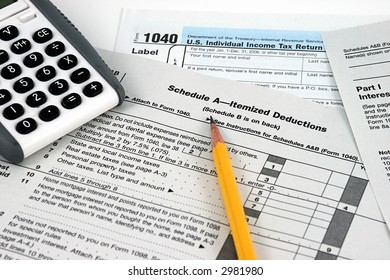 IRS personal Tax forms with pencil and calculator