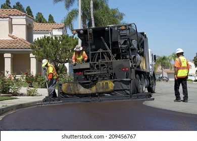IRVINE, CA - AUGUST 06, 2014: Irvine's residential street rehabilitation and slurry seal project finished with crews expertly applying the emulsified asphalt (slurry seal).