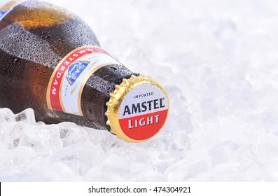 IRVINE, CA - AUGUST 26, 2016: A bottle of Amstel Light on a bed of ice. Founded in 1870 it was taken over by Heineken in 1968, produces over 36 million liters yearly.