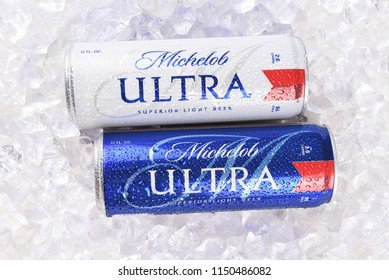 IRVINE, CA - AUGUST 6, 2018: Two Michelob Ultra beer 12 ounce cans in ice. A a low carb and low calorie light beer from Anheuser-Busch.