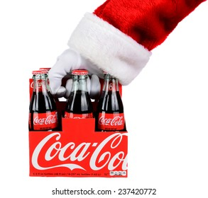 IRVINE, CA - DECEMBER 12, 2014: Santa Claus holding a 6 pack of Coca-Cola Classic bottles. Coca-Cola is the one of the worlds favorite carbonated beverages.
