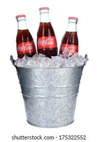 IRVINE, CA - FEB 06, 2014: Threes bottles of Coca-Cola in and Ice bucket. Coke is one of the most popular soft drinks in the world.