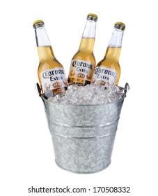 IRVINE, CA - January 09, 2014: Three Bottles of Corona Extra in a Bucket of Ice. Corona is the most popular imported beer in the United States.