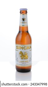 IRVINE, CA - JANUARY, 11, 2015: A single bottle of Singha Beer. Produced by Boon Rawd Brewery it is the only brewery permitted to display the royal Garuda on the bottleneck.