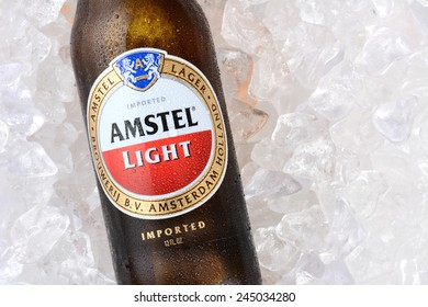 IRVINE, CA - JANUARY 11, 2015: A bottle of Amstel Light on a bed of ice. Founded in 1870 it was taken over by Heineken in 1968, produces over 36 million liters yearly.