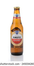 IRVINE, CA - JANUARY 11, 2015: A bottle of Amstel Light isolated with reflection. Founded in 1870 it was taken over by Heineken in 1968, the brewery produces over 36 million liters yearly.