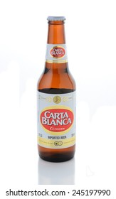 IRVINE, CA - JANUARY 11, 2015: A bottle of Carta Blanca Beer on white. From Cerveceria Cuauhtemoc-Moctezuma, founded in 1890, now a subsidiary of Heineken International.