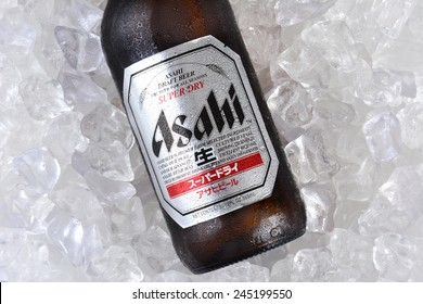 IRVINE, CA - JANUARY 11, 2015: A bottle of Asahi Super Dry Beer closeup on a bed of ice. Asahi was founded in Osaka, Japan in 1889 as the Osaka Beer Company.
