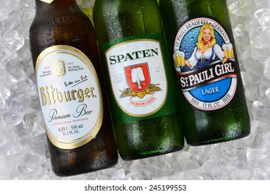 IRVINE, CA - JANUARY 11, 2015: Three bottles of German beerson a bed of ice. St. Pauli Girl, Spaten and Bitburger are three popular German beers imported into the United States.