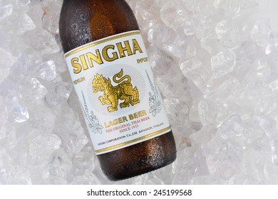 IRVINE, CA - JANUARY 11, 2015: Closeup of a single bottle of Singha Beer on ice. Produced by Boon Rawd Brewery it is the only brewery permitted to display the royal Garuda on the bottleneck.