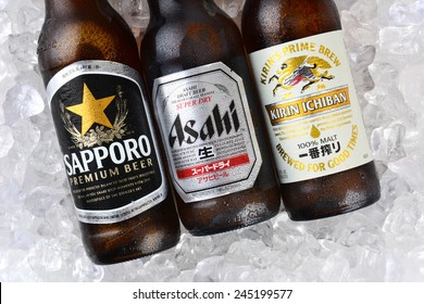 IRVINE, CA - JANUARY 11, 2015: Three bottles of Japanese beers on a bed of ice. Sapporo, Asahi and Kirin Ichiban are three of the most popular Japanese beers imported into the USA