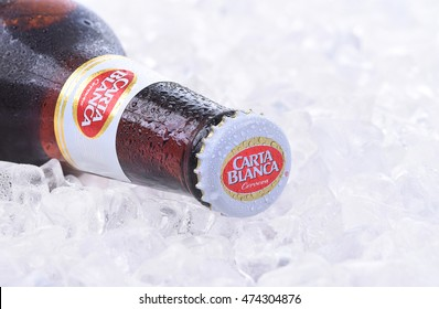 IRVINE, CA - JANUARY 11, 2015: A bottle of Carta Blanca Beer, closeup on a bed of ice. From Cerveceria Cuauhtemoc-Moctezuma, founded in 1890, now a subsidiary of Heineken International.